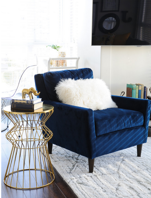 bedroom chair navy covers wedding prices how to match your with a contemporary rug apartment can t get enough of this velvet especially when paired all