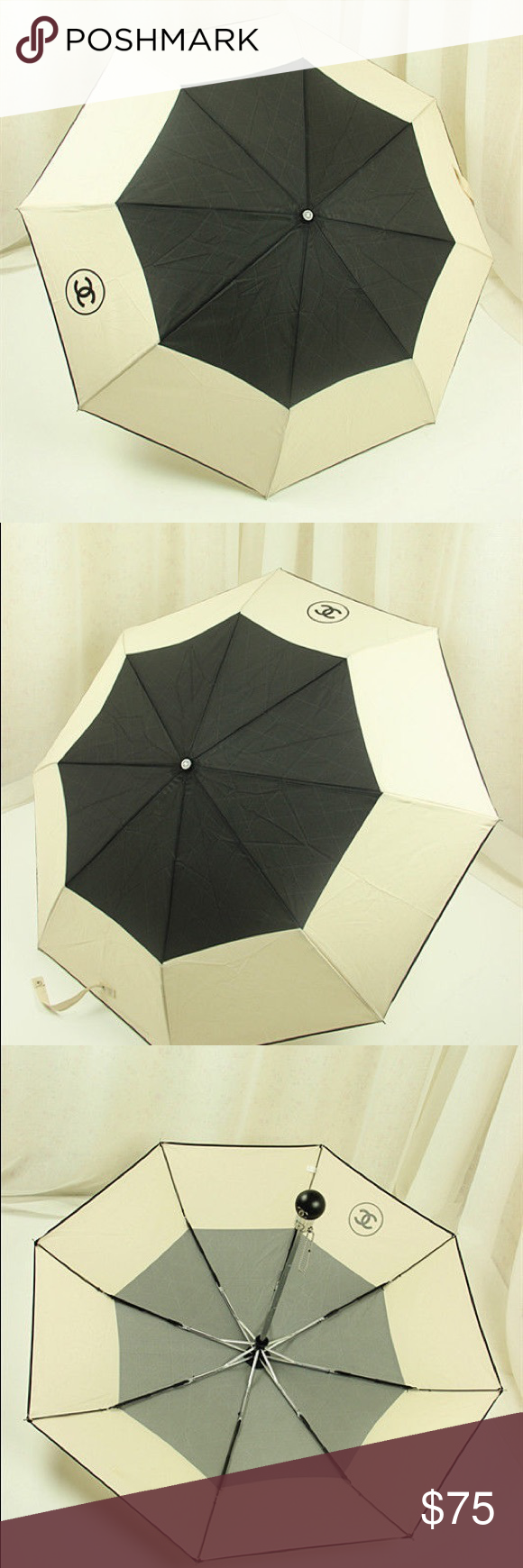 """New Chanel Black and Beige Nylon Camellia Umbrella ️PRICE IS FIRM❗️ New Never Used. High quality. Not orig.  Chanel stylish black and beige nylon umbrella in Chanel box  The chic umbrella comes with a quilted nylon carrying case on a silver metal chain strap.   Measurements  The diameter measures 38.5 inches open from point to point The chrome metal handle measures 20"""" inches in length CHANEL Accessories Umbrellas"""