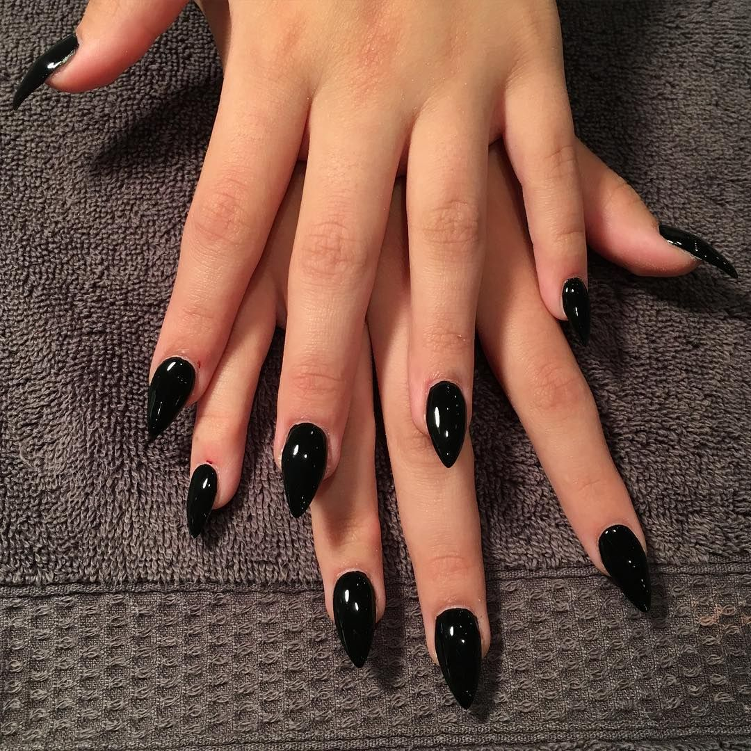 jet-black nails are not missing from the list of the trendiest