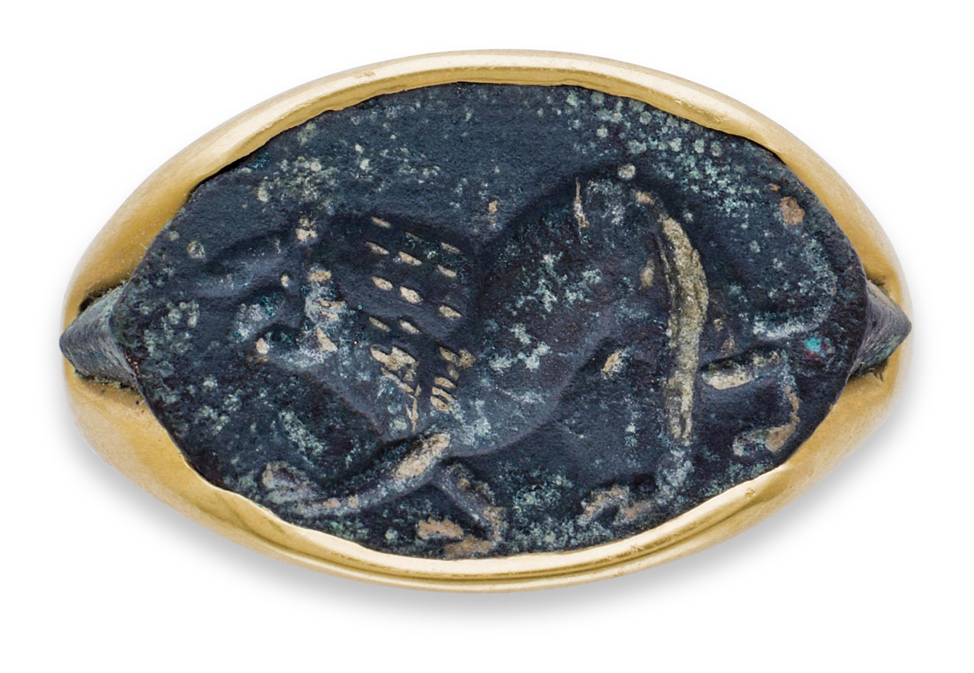 A GREEK BRONZE RING BEZEL WITH A LION