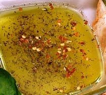 SANDRA'S ITALIAN OLIVE OIL DIPPING SAUCE for WARM TORN BREAD - A fantastically flavorful first course appetizer to serve with a nice glass of wine before the main course or as a divine and romantic snack at other times (Click on image for recipe)...