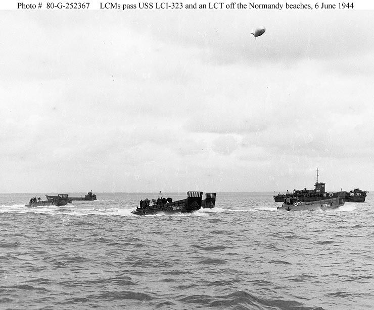 Photo #: 80-G-252367  Normandy Invasion, June 1944  LCM landing craft pass USS LCI(L)-323 (at right, with a barrage balloon overhead) and an LCT off the invasion beaches, 6 June 1944. Taken by Combat Photo Unit Eight (CPU-8).  Official U.S. Navy Photograph, now in the collections of the National Archives
