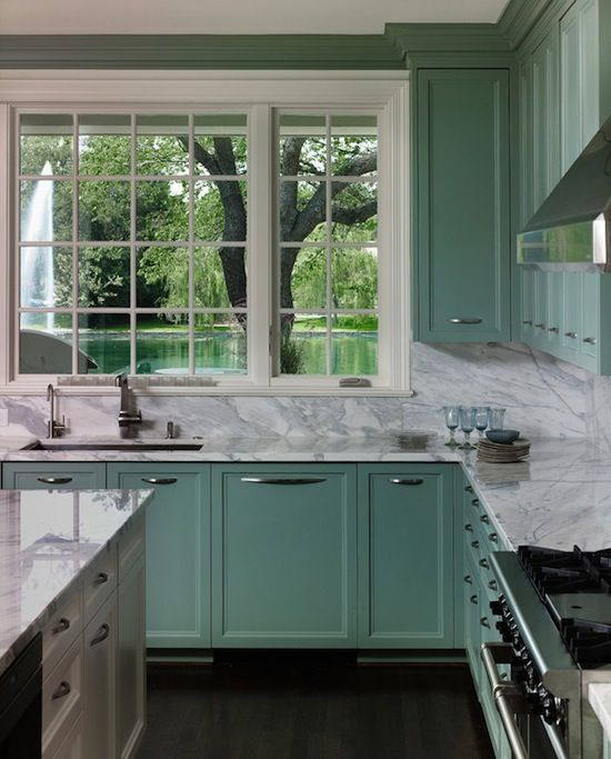 The Seafoam Green Cabinets Adds A Warm Color To The Room That