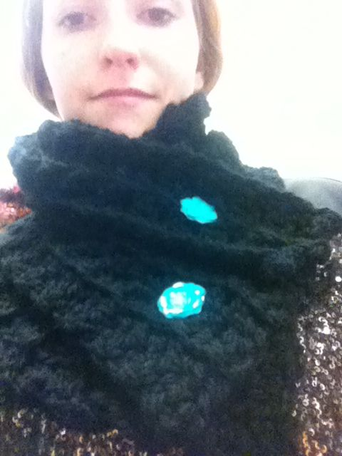 This one has pretty bright teal flower buttons that really pop off the black