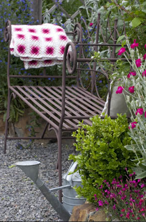 Outdoor bench with a blanket for chilly nights