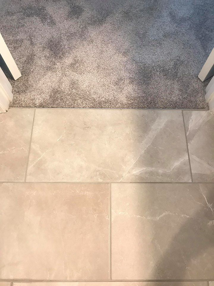 12x24 Tile To Carpet Transition In Master Suite Using Schluter Profile Carpet To Tile Transition Flooring Bathroom Remodel Designs