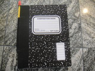 Tape a large straw to the cover of notebook to hold pencil