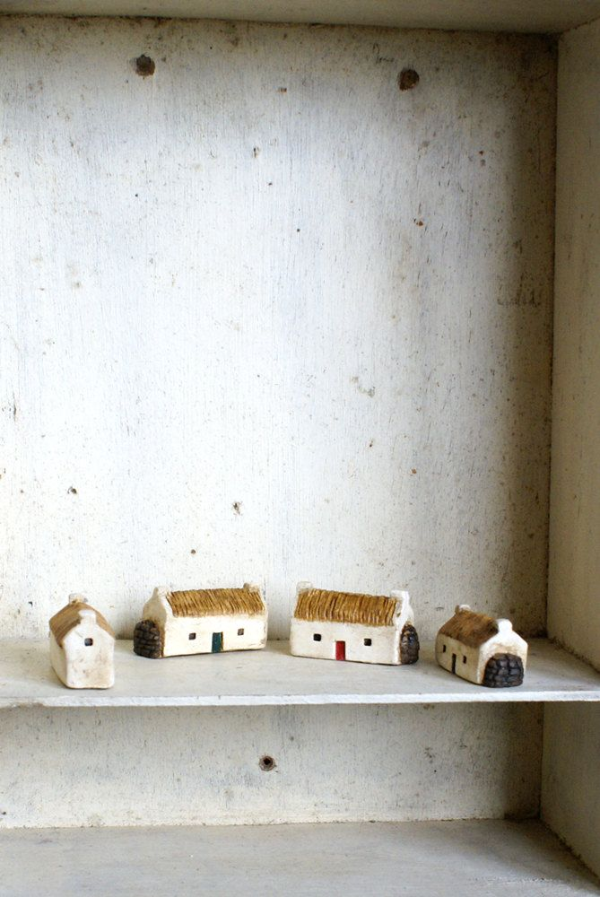 each miniature irish cottage is inspired by an actual cottage, with thatched roof and winter woodpile.