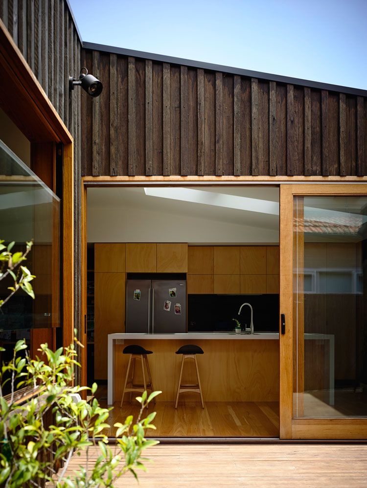 Batten And Board House A Simple Box Transforms A Weatherboard House Cladding Exterior Cladding Cladding