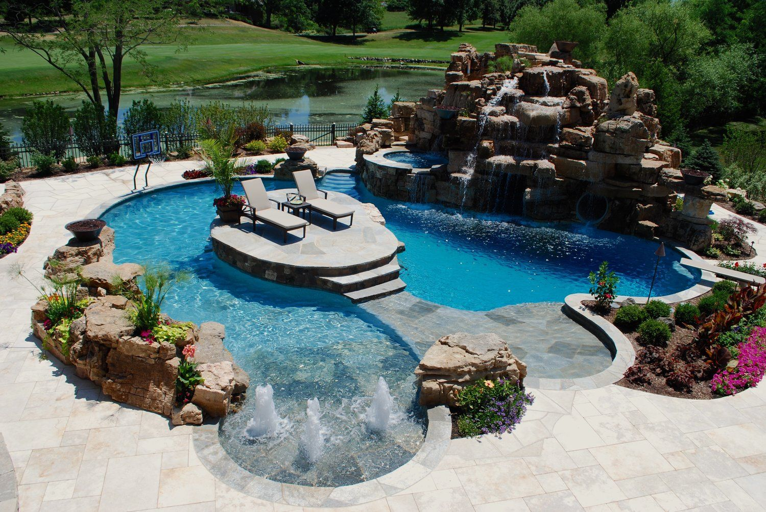 Custom Pool With Island Slide Rock Mountain Diving Board Hot Tub Grotto By Southampton Builders Llc Diving Board Custom Pools Pool Houses