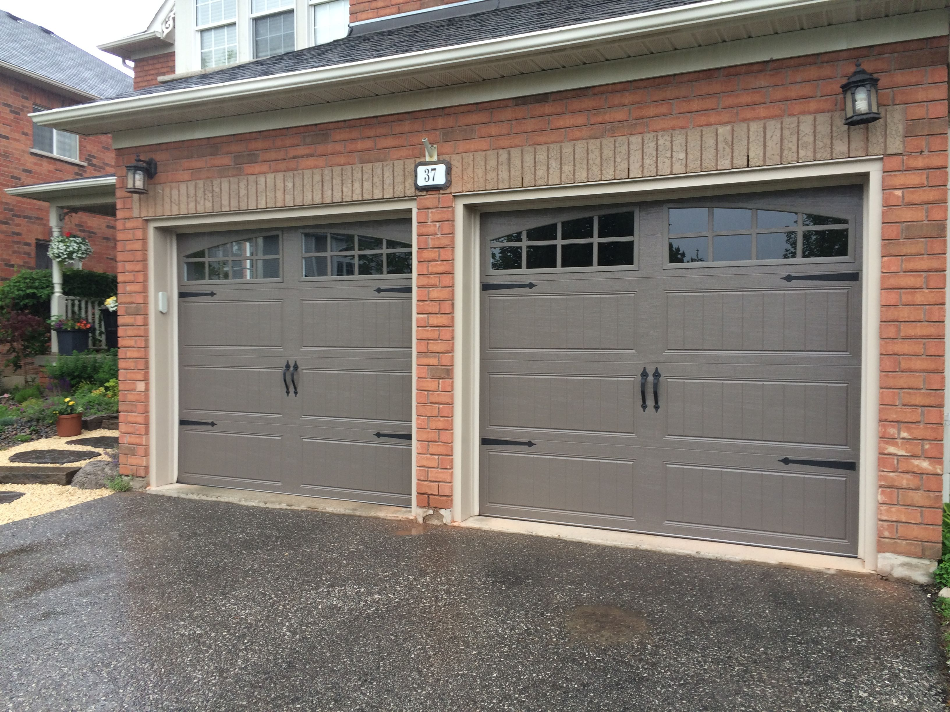 8x7 clopay steel insulated bronze carriage doors with true for Buy clopay garage doors online