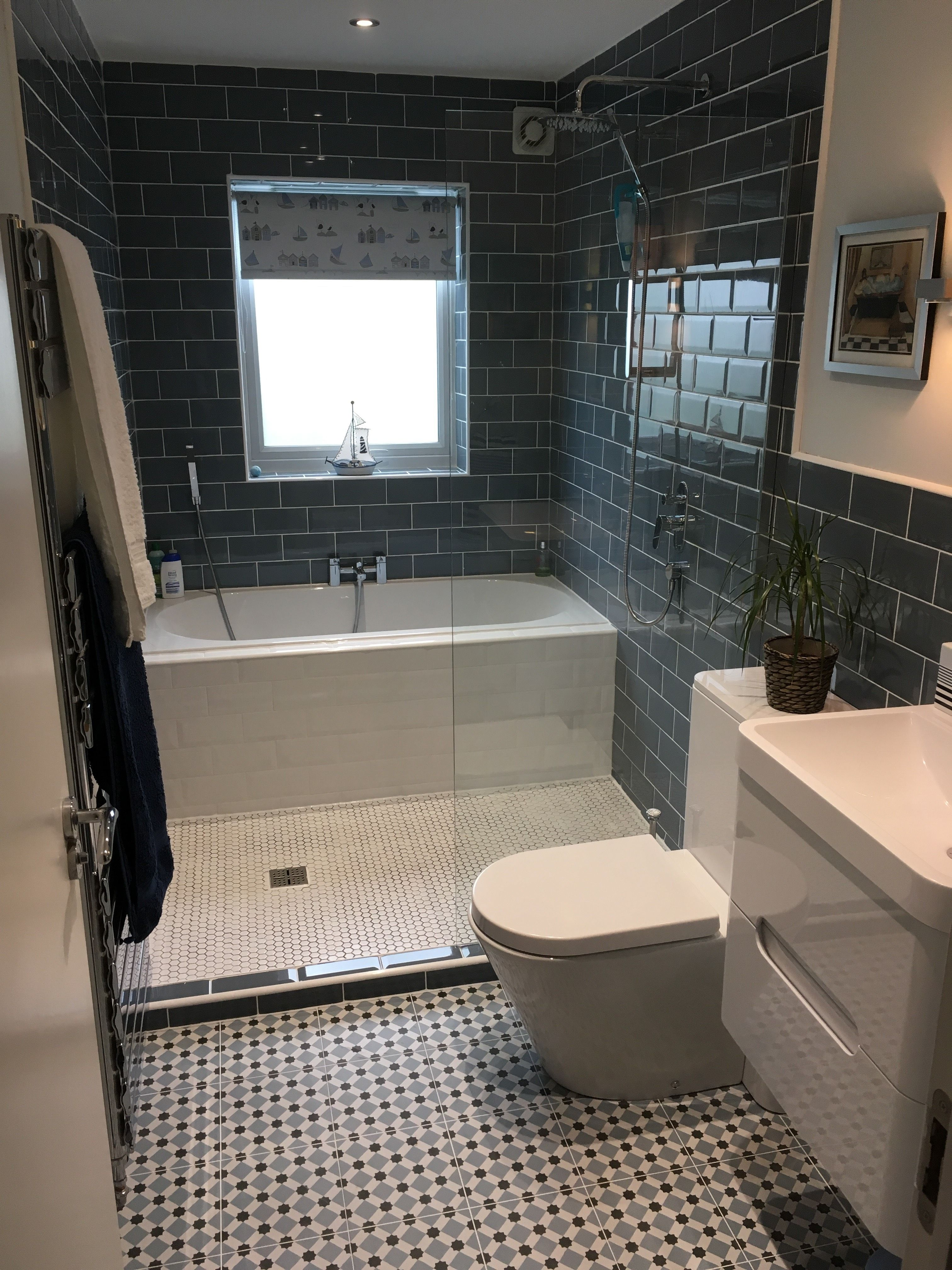 In the bathroom while taking a shower or a well deserved bubble bath - Look At The Great Use Of Space With A Bath And A Shower In This Innovative