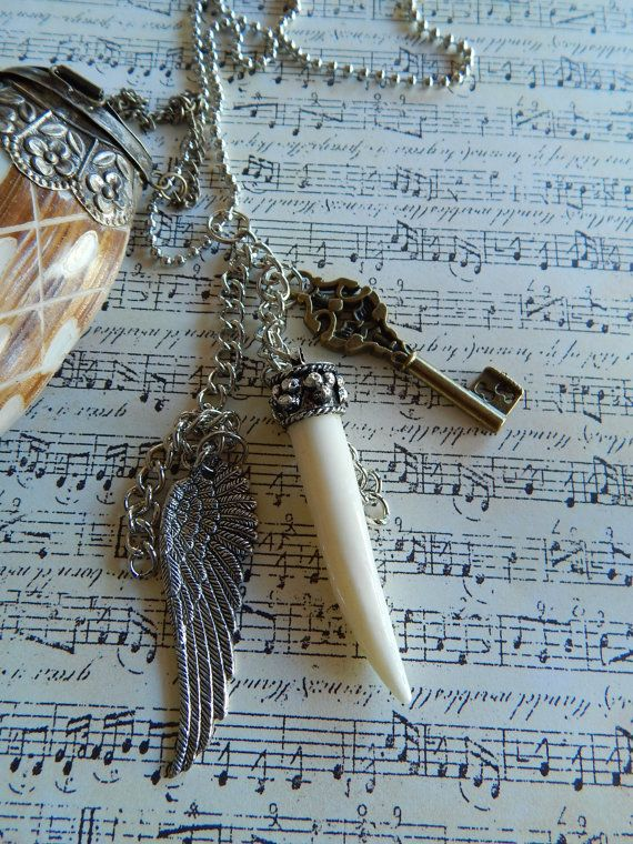 Silver chain necklace with wing key and tusk charms. by NomadTrade, $12.00