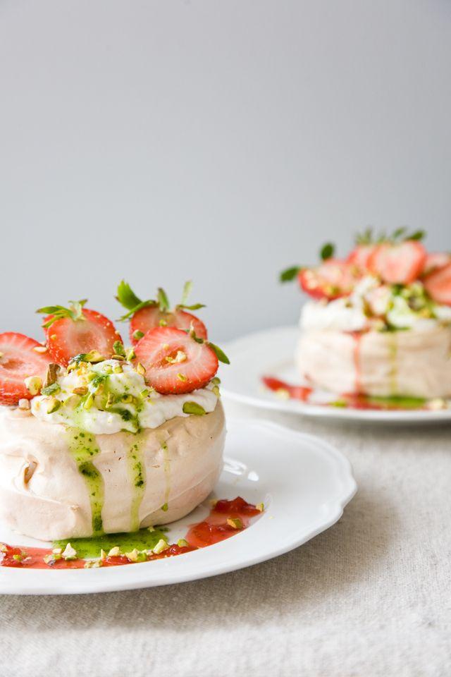 Pavlovas with Strawberries, Vanilla Cream, and Basil Coulis