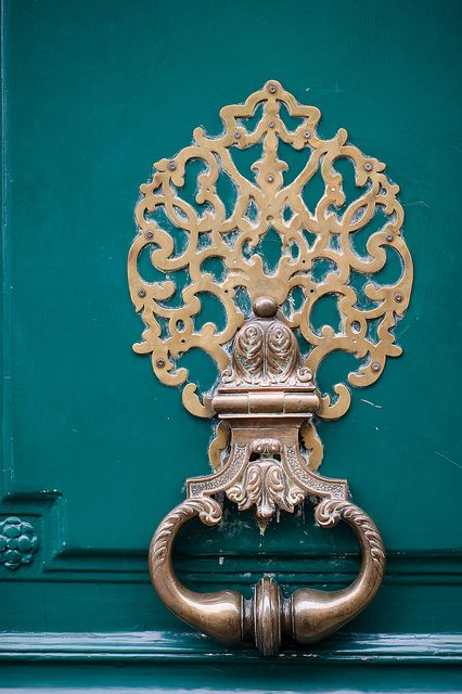 Beautiful Knocker in Paris, I love the way it pops off the teal door