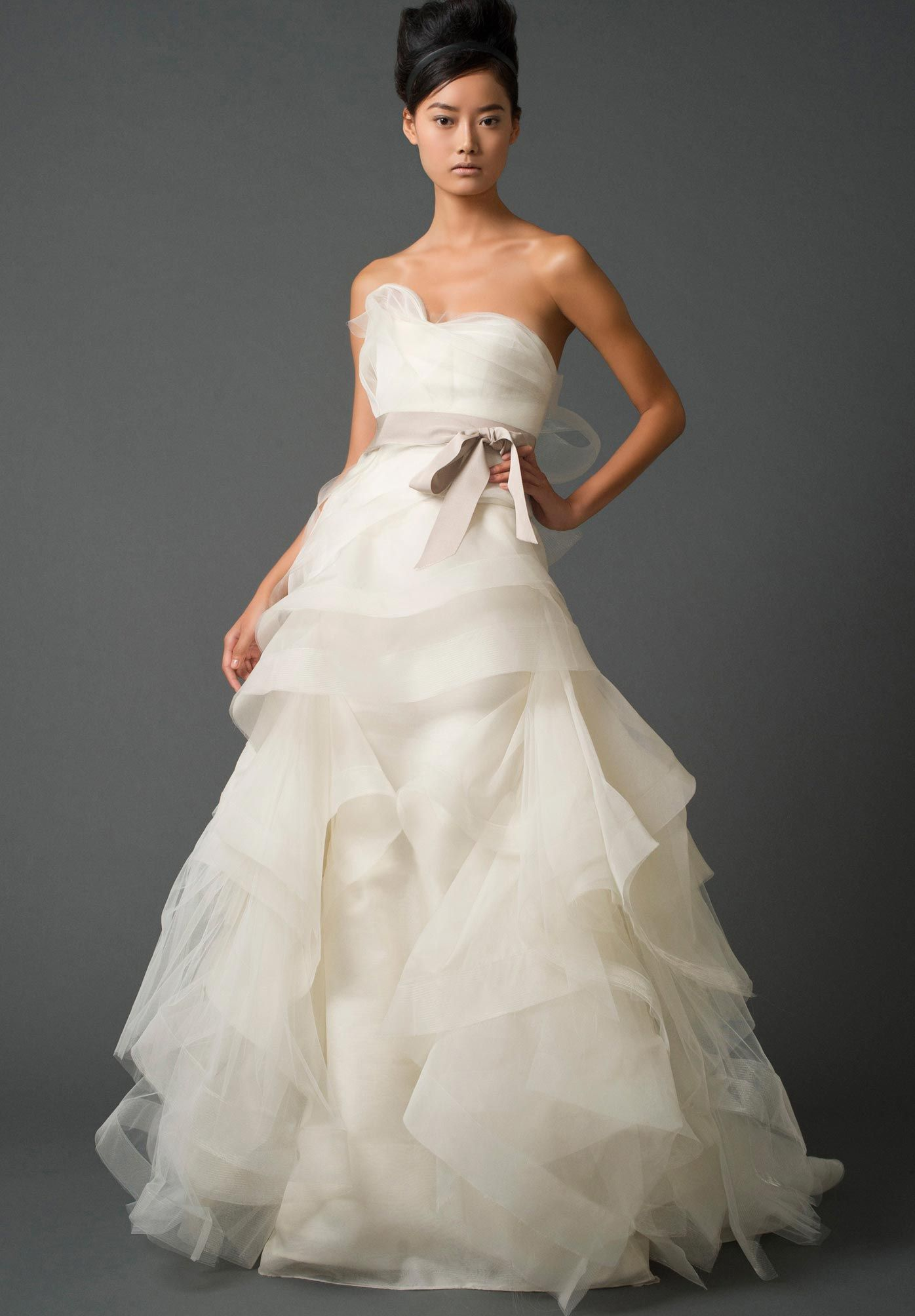 Vera Wang-I adore the bottom. I will certainly be wearing one of her designs on my big day!