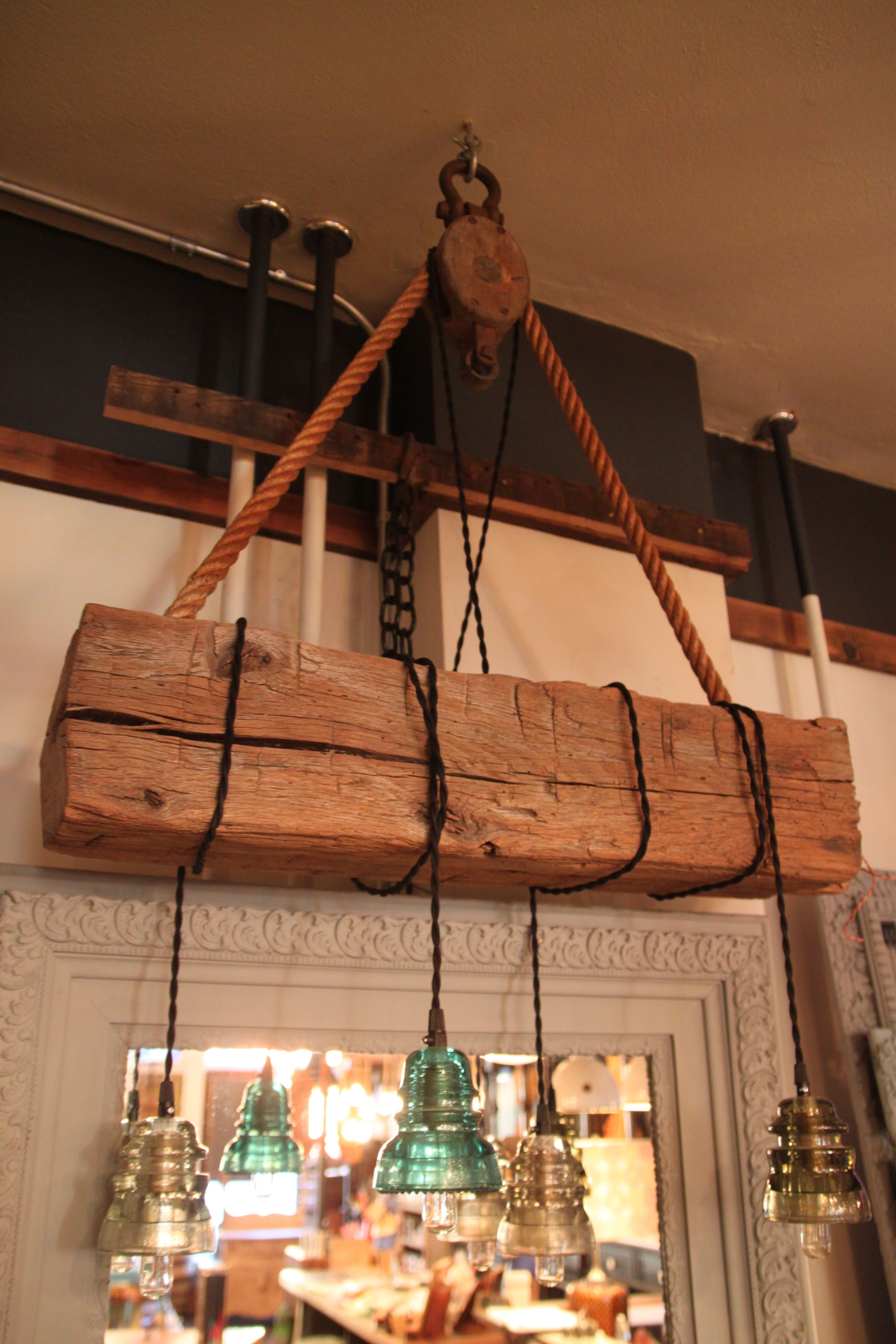 Hand Hewn Barn Beam With Hanging Vintage Insulators