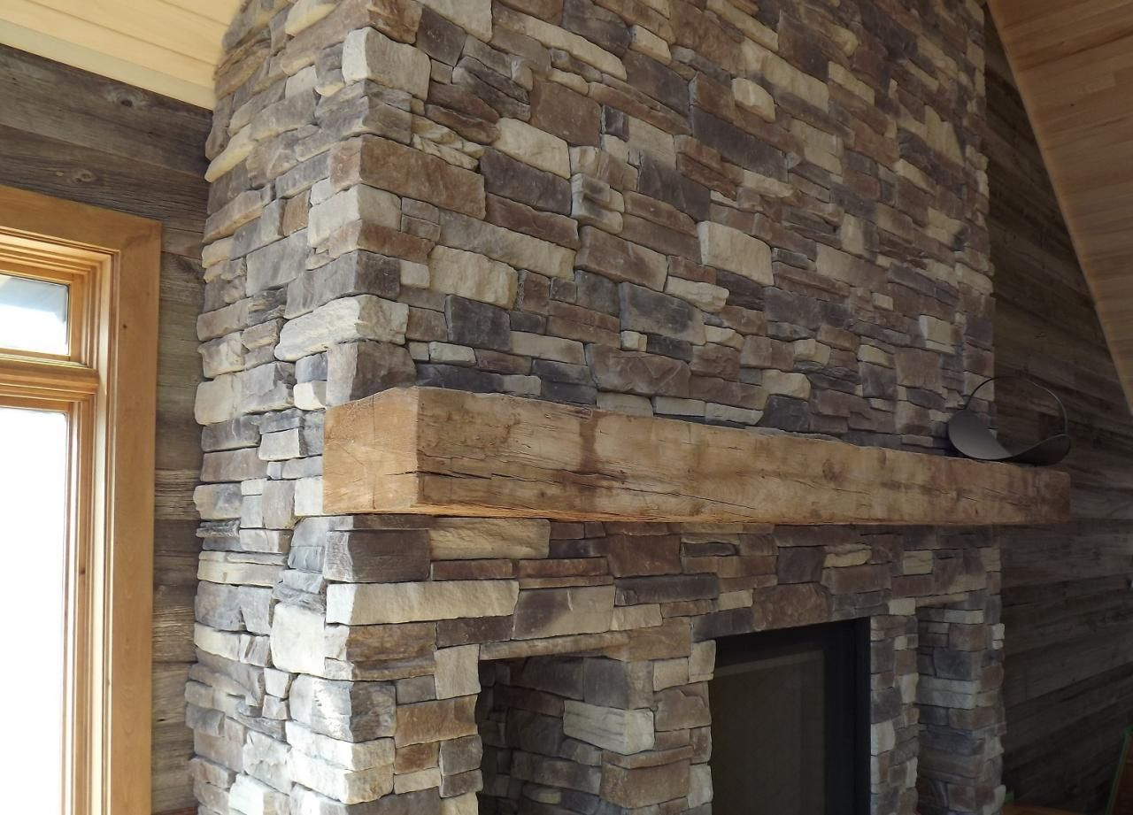 reclaimed fireplace mantel and barn board wall coverings