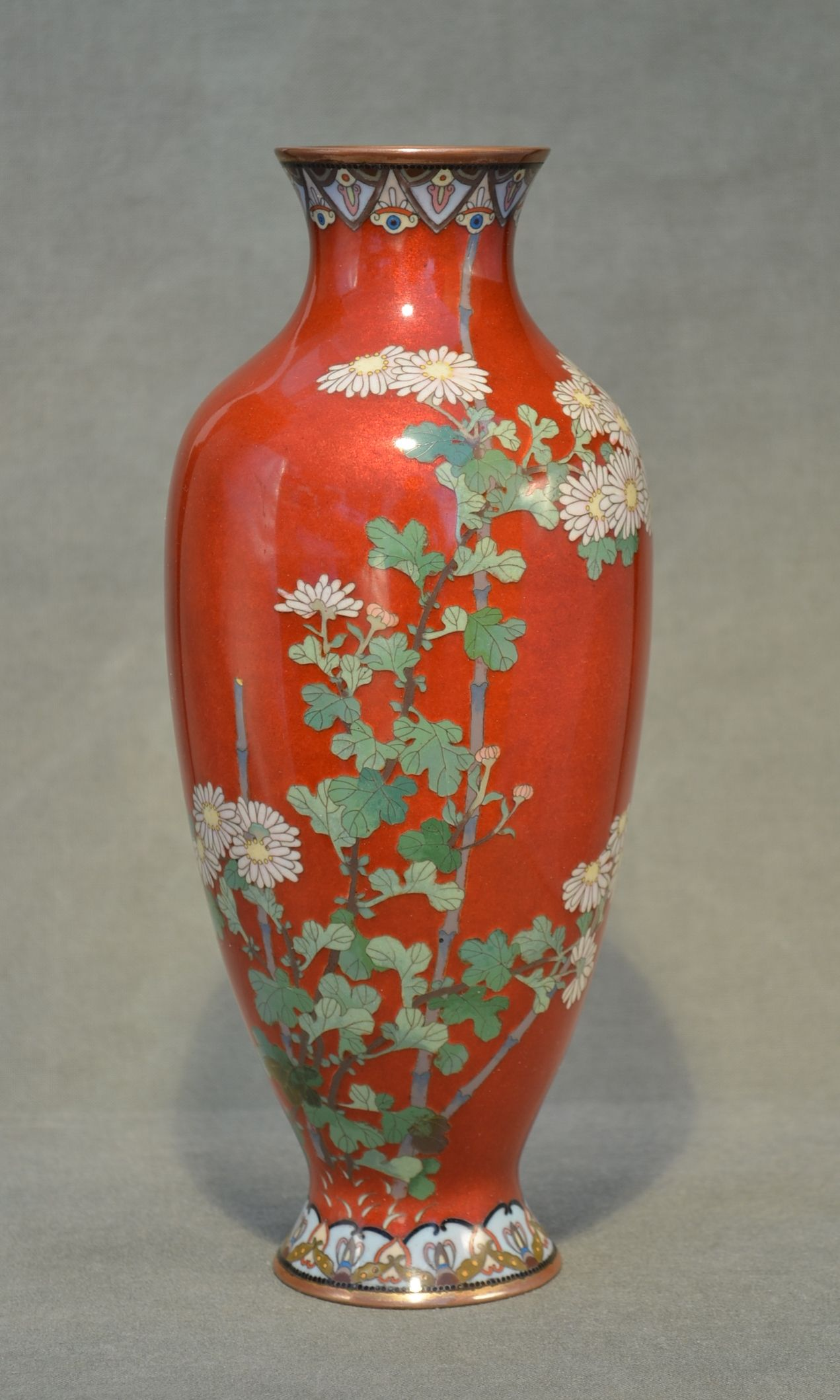 Title: A pair of Cloisonné Vase Description: decroated flowers in silver wire on red background Artist: unsigned Date: circa 1900 SIze: 25cm high