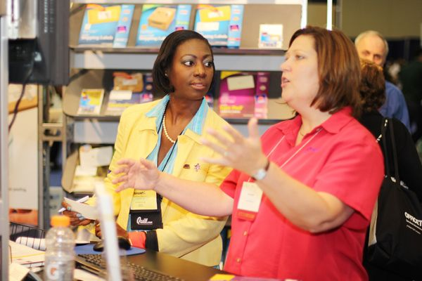 An Efam Attendee Hears From A Company Representative During The