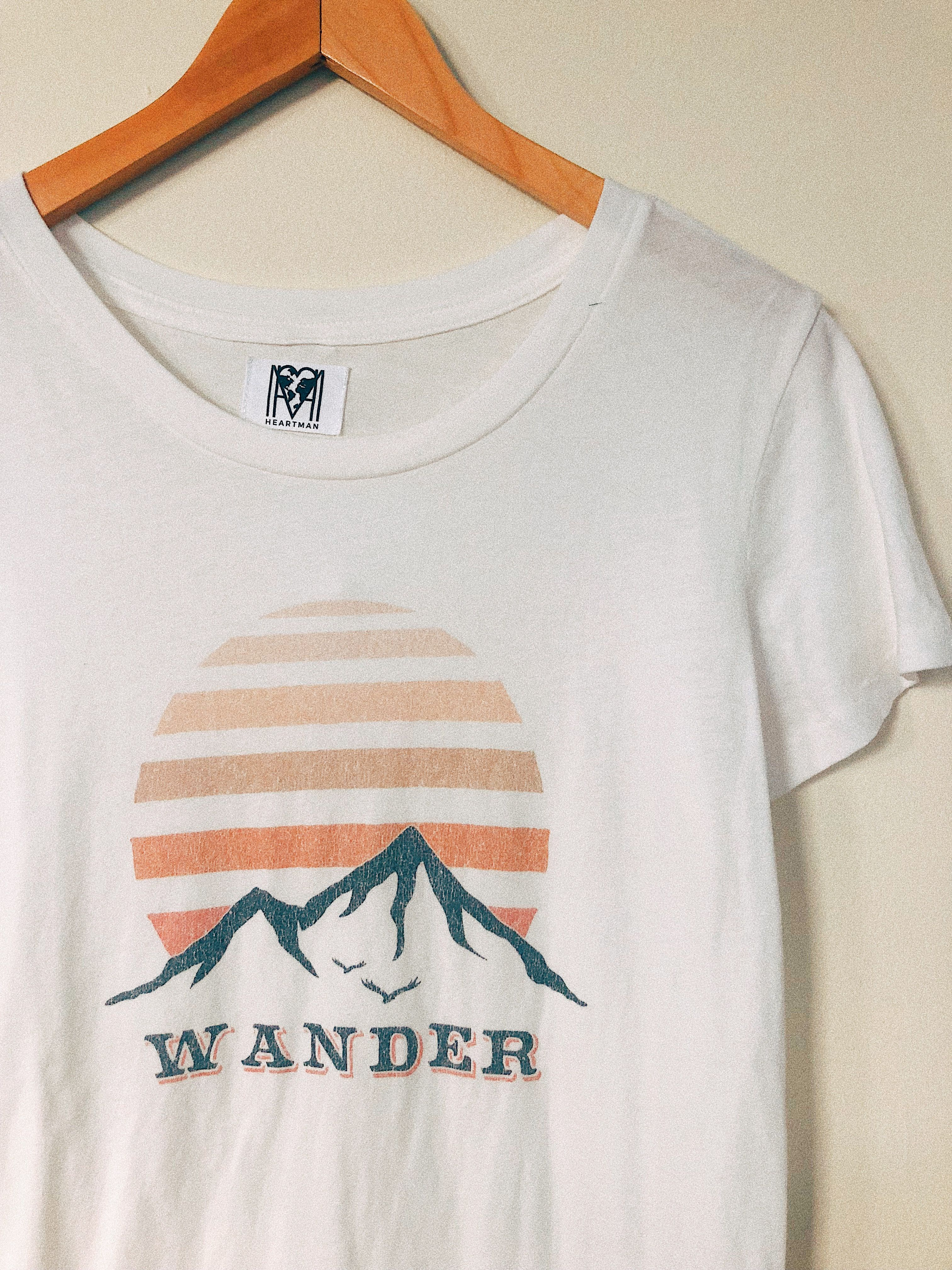 cc51b478 Our vintage inspired Wander graphic t-shirt features a peachy distressed  mountain range. #graphictee #mountain #vintage
