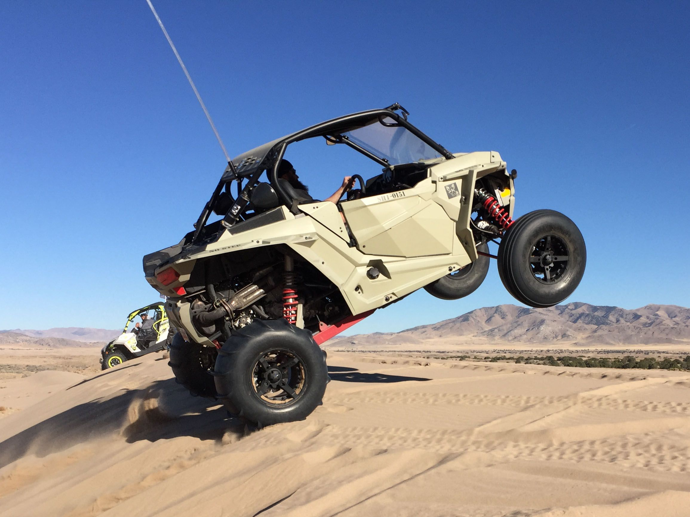 Desert Tan Polaris RZR XP 1000 2 seat with a Vent Racing Coupe Cage