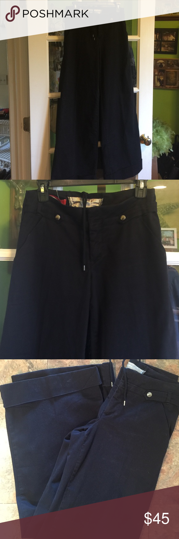 Beautiful wide leg black pants Very stylish wide leg cuffed pants . 98% cotton and the rest is spandex. Very well made pants with zipper and snap detail on front. Lace up in back cartonnier Pants Wide Leg