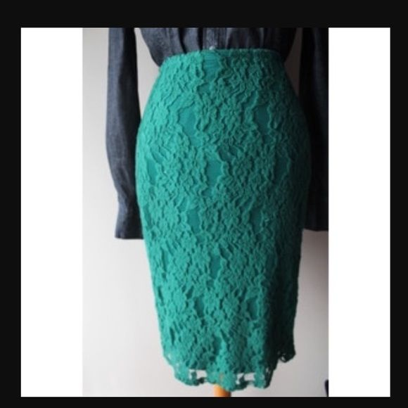 Emerald lace pencil midi skirt This has never been worn! Deep green color. No flaws, wear, nor tear. The length is to the knee, and the zipper in the back is gold. Xhilaration Skirts Midi