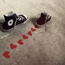 Black converse with hearts