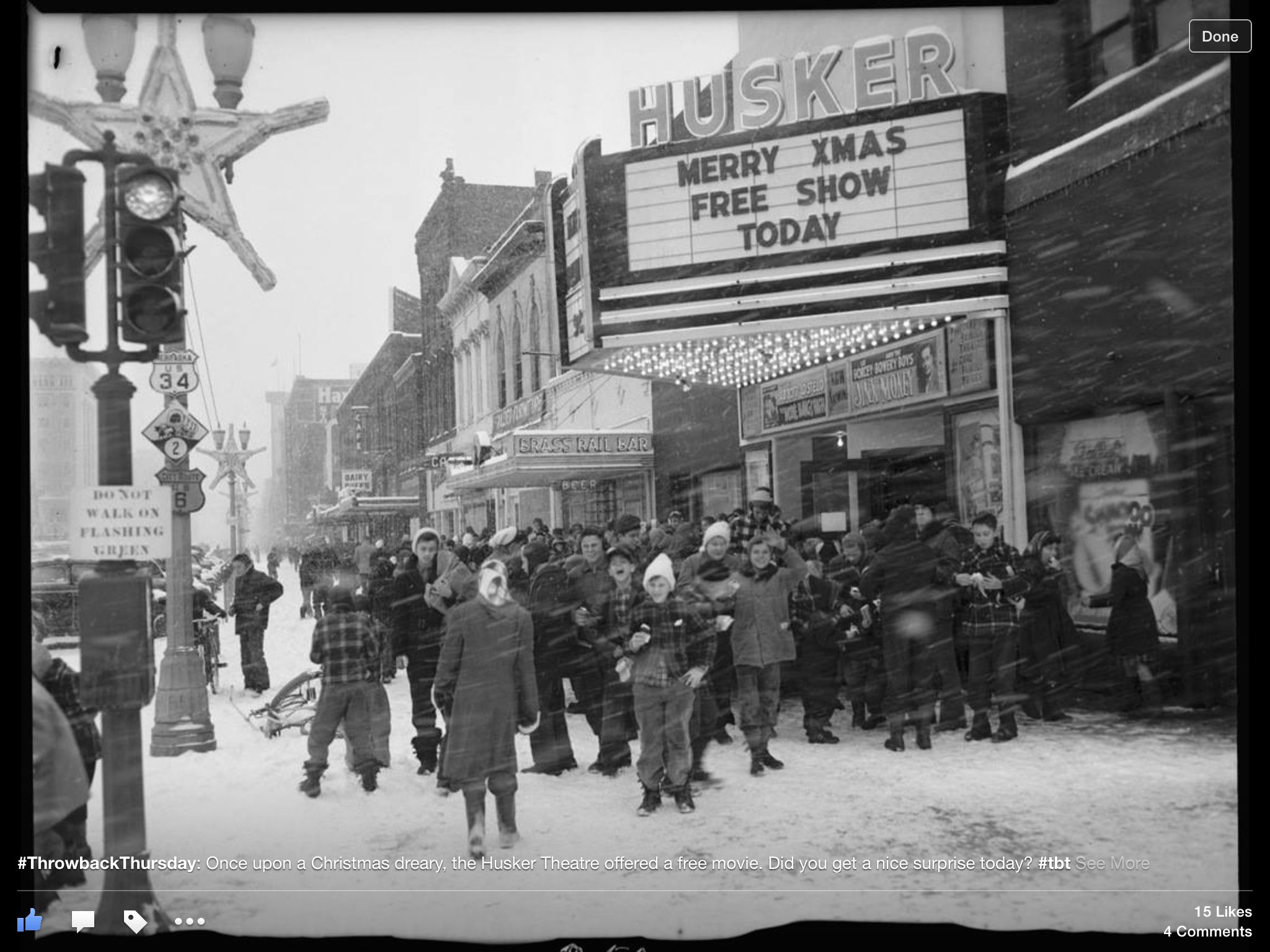 """This crowd in front of the Husker Theater at 1444 O Street in Lincoln was treated to a free holiday show on December 24, 1948. Although the Husker's advertisement in the Lincoln Star the day of the show stressed that """"Everyone is Invited,"""" such events were often aimed at a young audience. Local merchants frequently sponsored free children's shows or movies during the holidays so that parents could shop while their kids attended the event."""