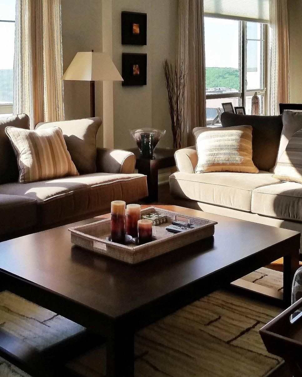 This Neutral Transitional Living Room Space Features Floor Length Curtains Two Couches Angled