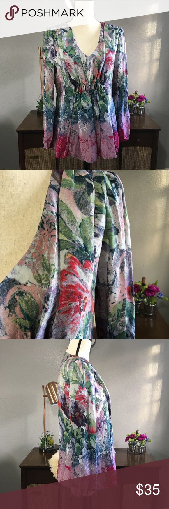 Sundance silk floral v neck blouse lined medium Beautiful multicolored floral silk long sleeve blouse from Sundance size medium. Exterior is 100% silk lining 100% polyester. Free of stains tears and holes. Measurements upon request Sundance Tops Blouses