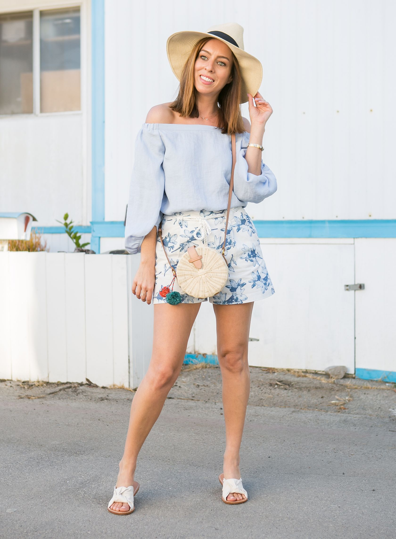 d698bec50ea Sydne Style shows how to wear floral shorts for summer vacation outfit ideas