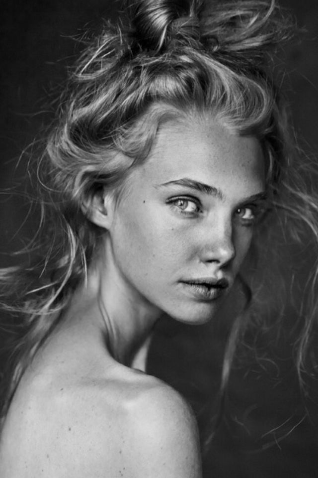 Black and white grayscale europien blond woman female portrait photography and professional headshot from front view fashion editorial photogra