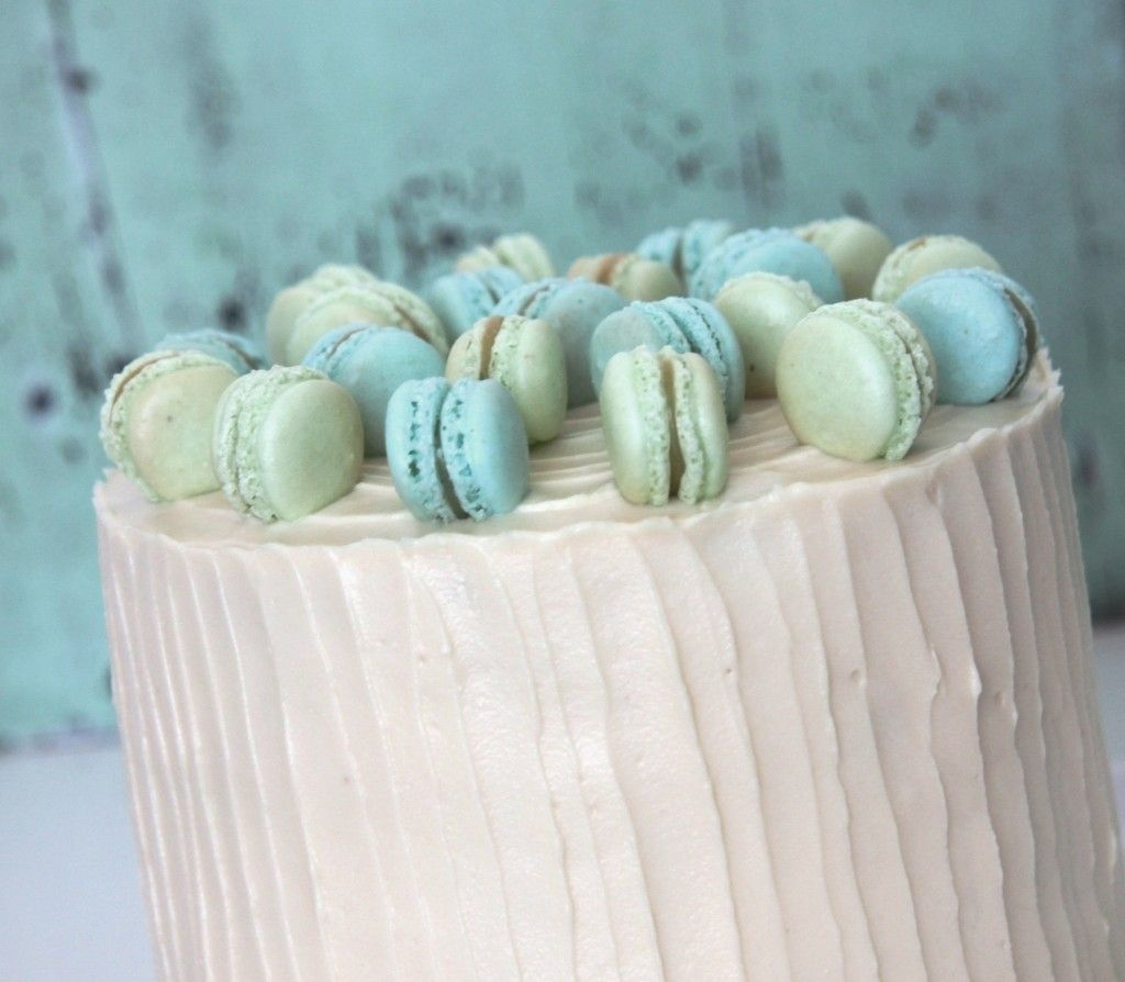 Blueberry and lemon cake with white chocolate frosting and mini macarons on top :-)