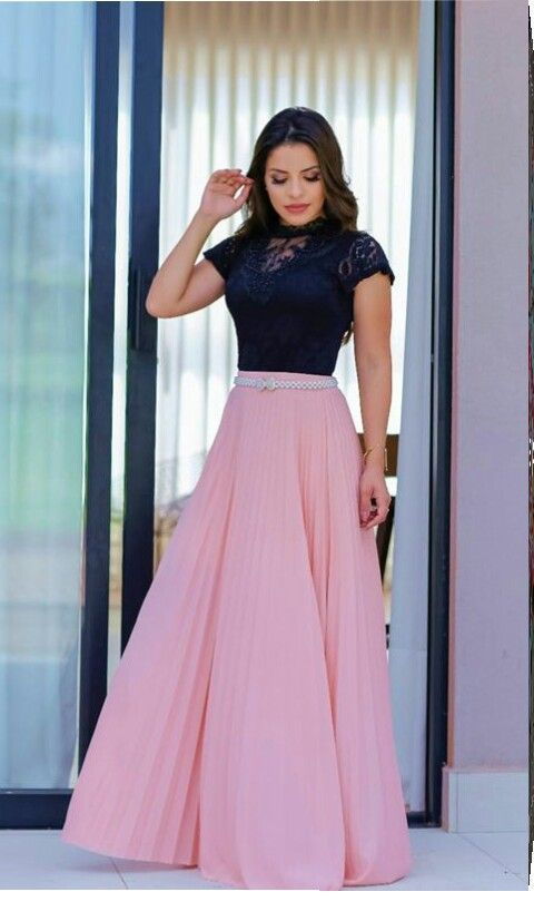 Black top and a long light pink skirt