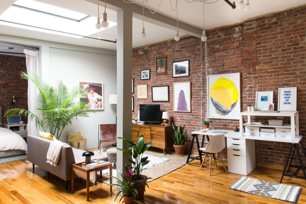 new york loft with exposed brick walls and a skylight apartment
