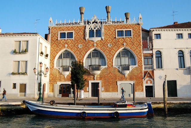 Casa dei Tre Oci, Italy {House of the Three Eyes} Such a lovely pattern to see next to the other homes.