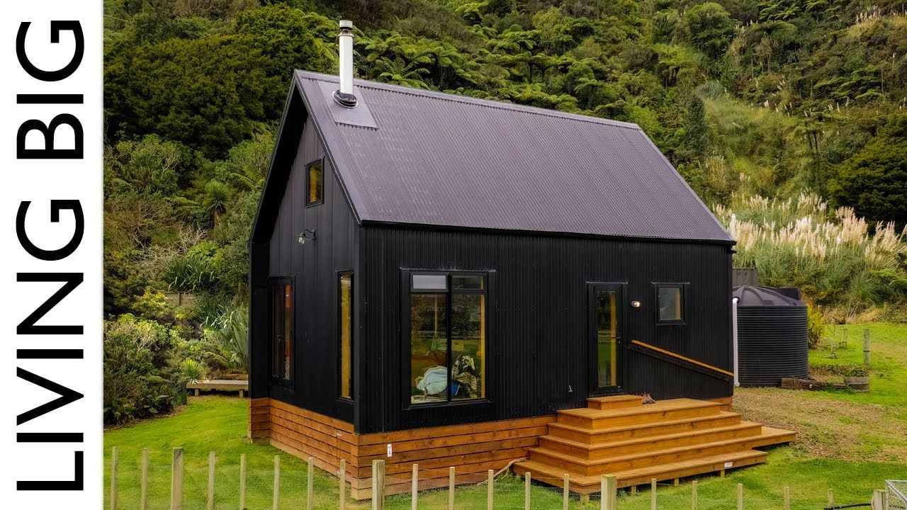 Stunning Black Off Grid Cabin By The River Tiny House Exterior Tiny House Cabin Off Grid Tiny House
