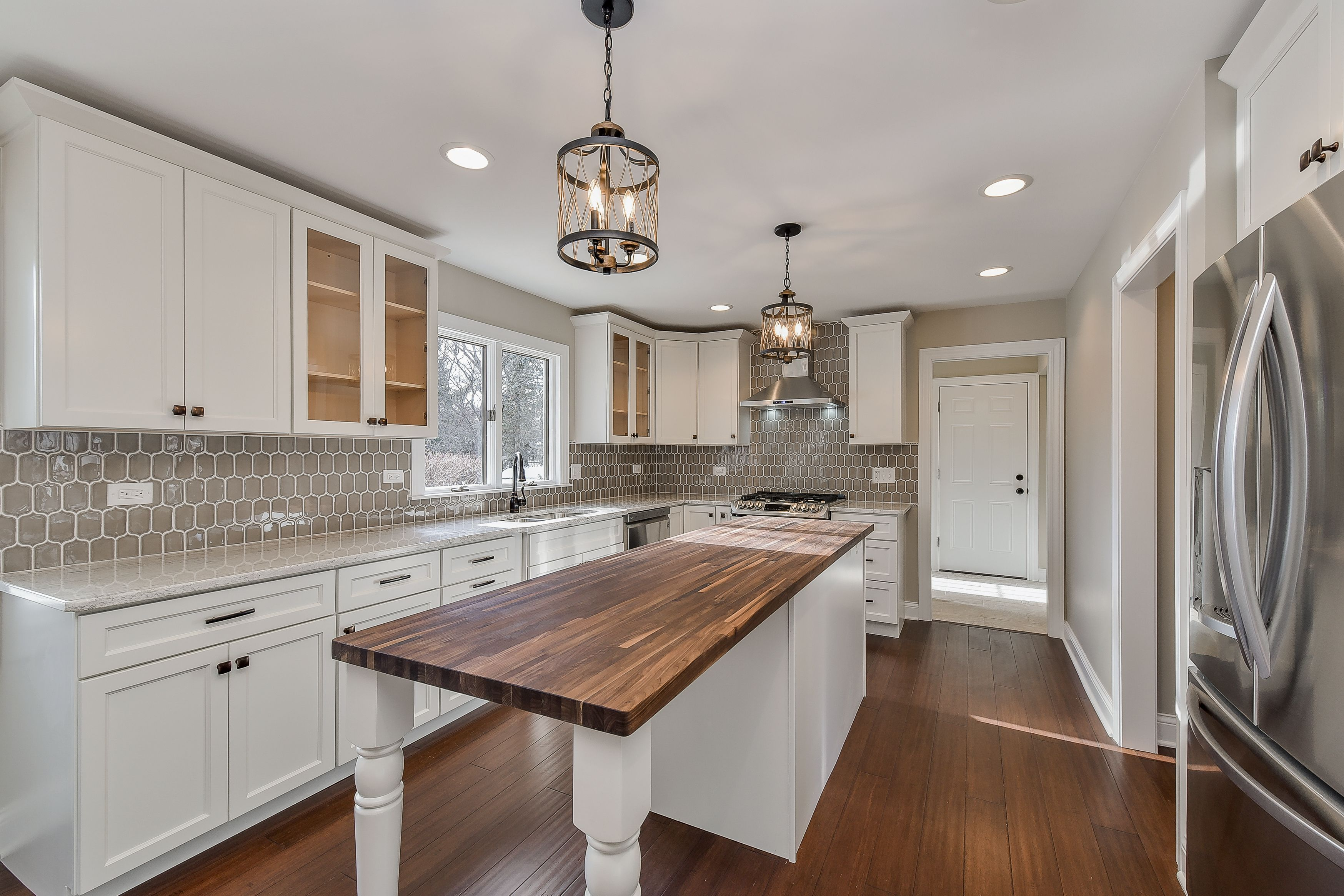 White Cabinets With Granite And Butcher