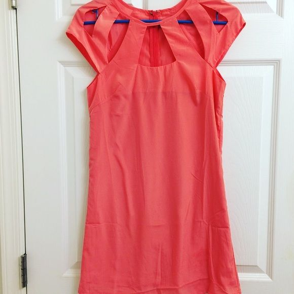 Coral cut out tobi dress! NWOT Beautiful coral dress with cut outs. Tobi size xsmall. Perfect condition (just doesn't fit unfortunately)! Polyester . Partially lined but not sheer :) NWOT unworn!! Tobi Dresses