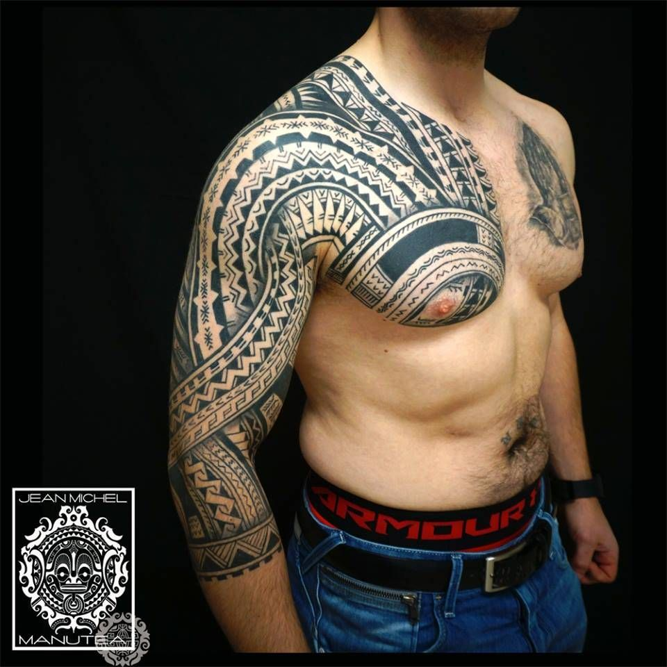 Polynesian Style Sleeve And Chest Tattoo.