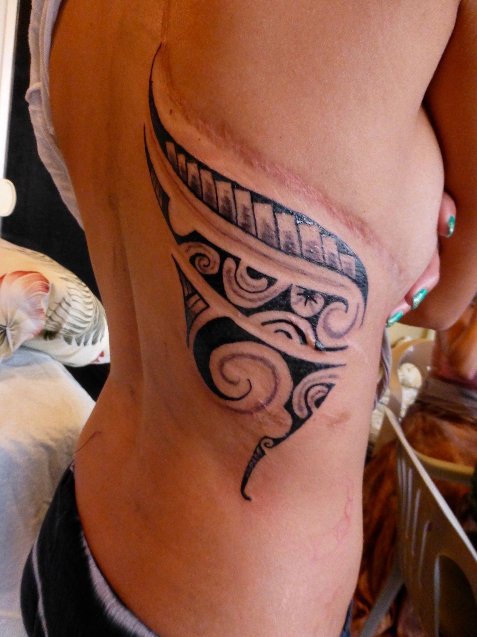 Sexy women with filipino tribal tattoo