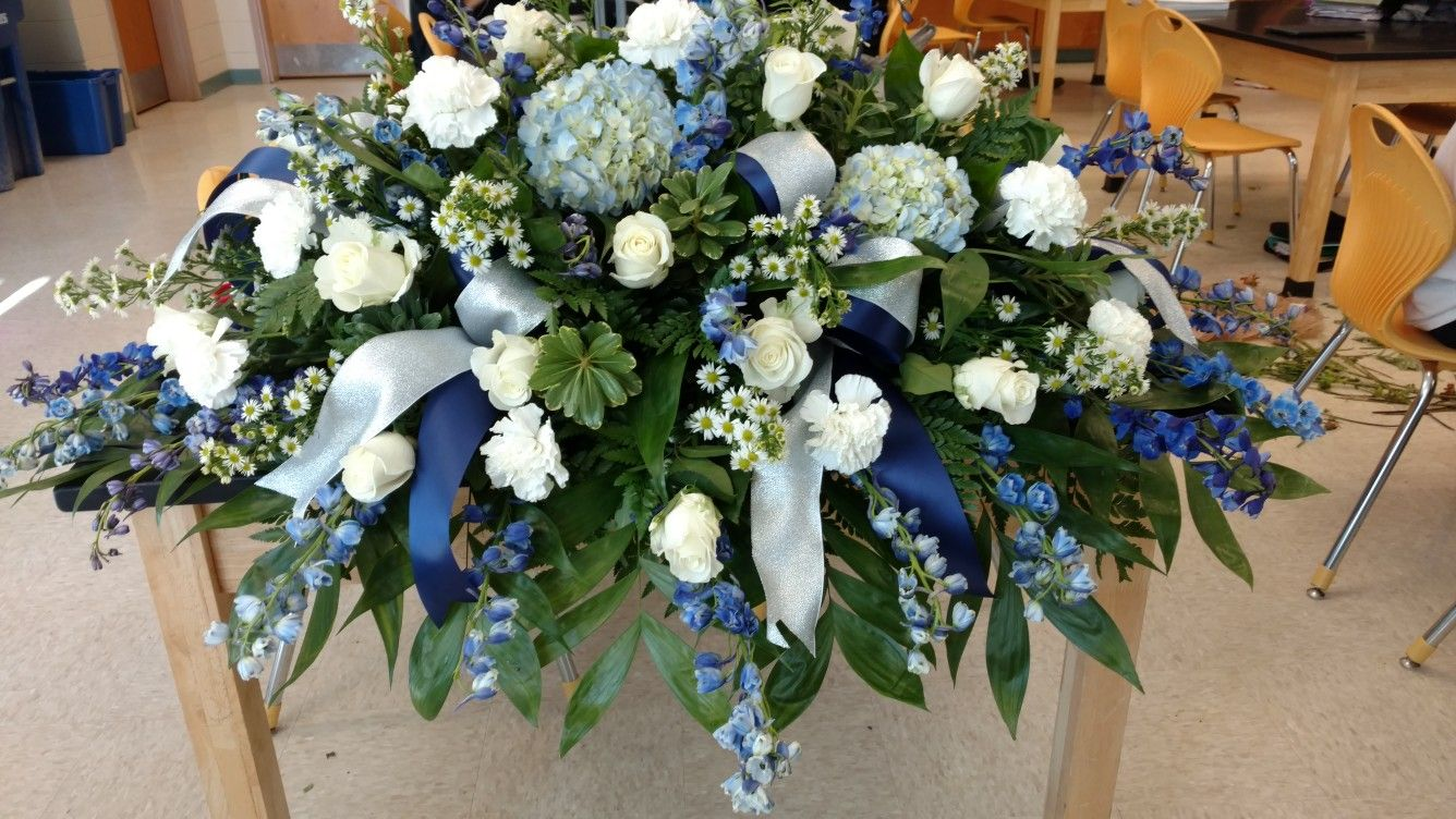 Blue White Silver Casket Spray Funeral Flowers With Hydrangeas Roses Delphinium Cowboys Inspir Casket Sprays Funeral Flower Arrangements Funeral Flowers