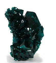DIOPTASE -Dioptase was first found in the late 18th Century. Copper miners discovered it and thought they'd found the emerald deposit of their dreams, however, when tested it was discovered that it is not as hard as emeralds -Dioptase is used as a pigment for paint.