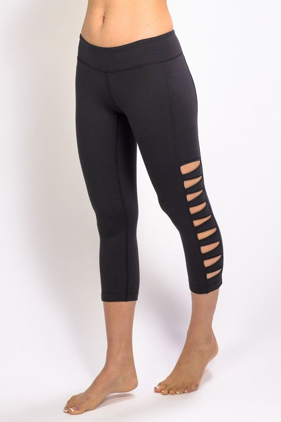 Love the cut out detail on these plain black yoga pants, gives them an edge.