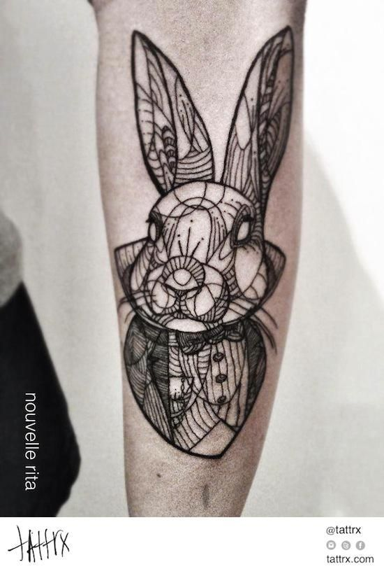This white rabbit tattoo is seriously awesome