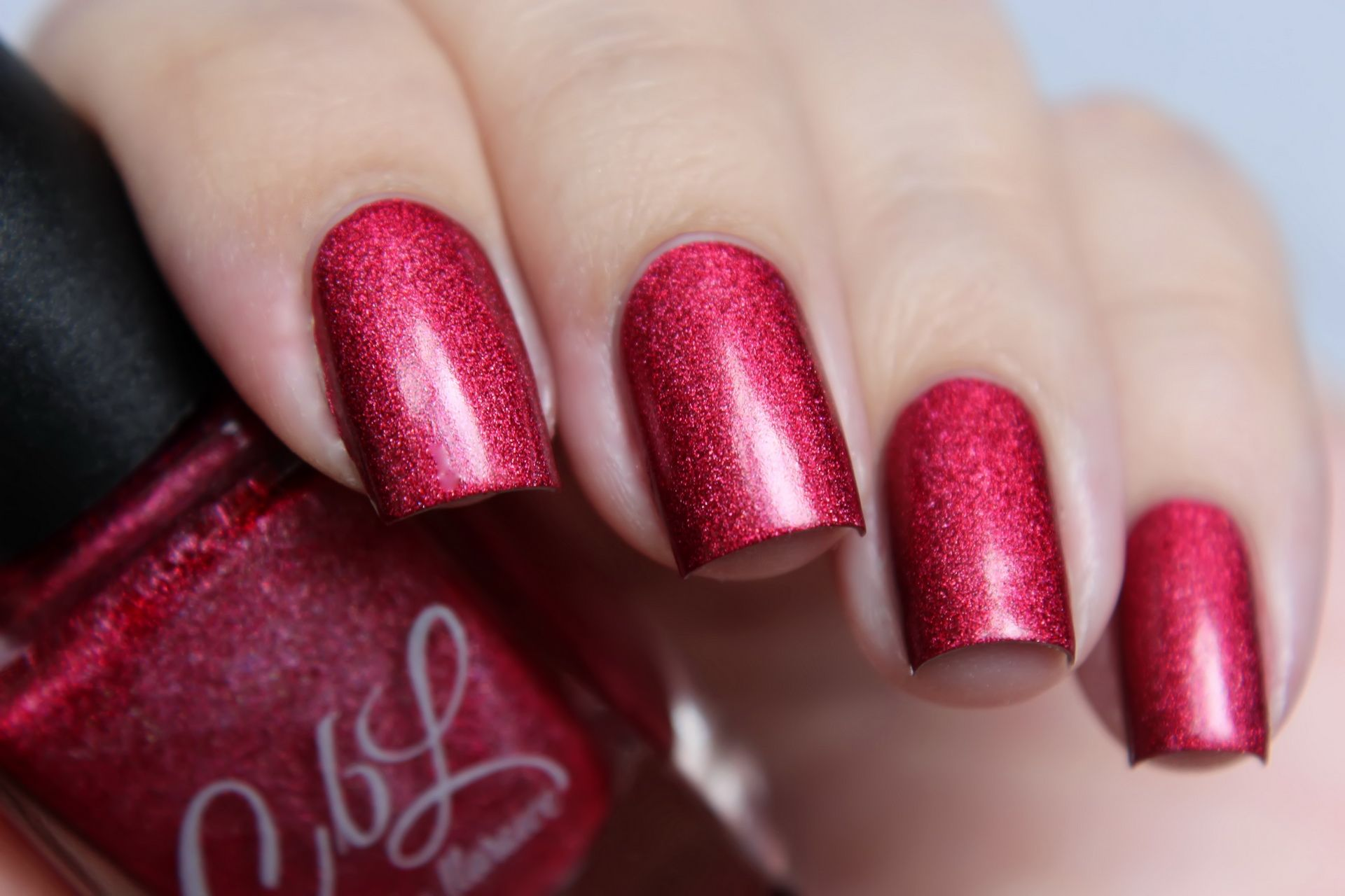 No, I'm Still Tacky - Bright cherry red holo with lighter red glow. This polish leans just a touch magenta. Pic taken in daylight shade. Swatch by @de_briz on Instagram.