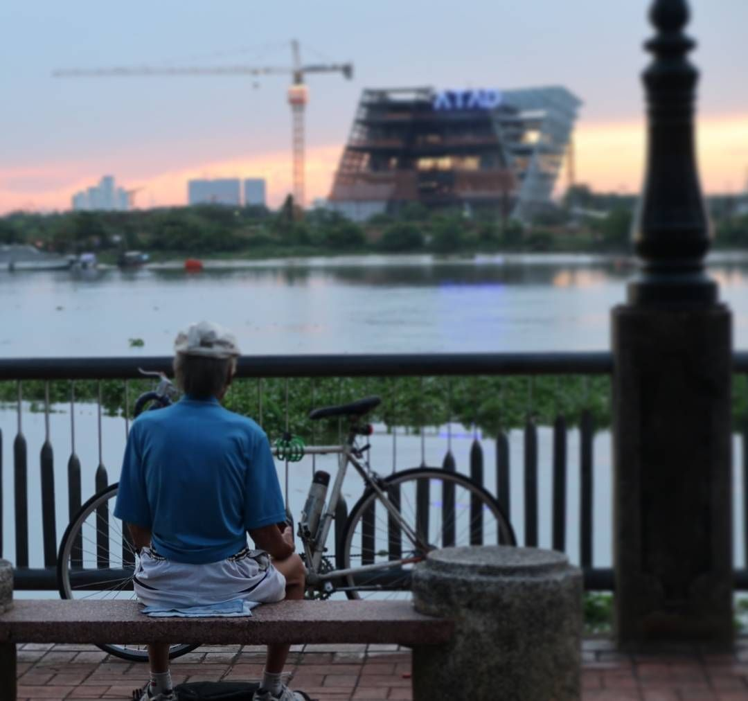 An old man ponders the new developments down by the fishing docks of Saigon.