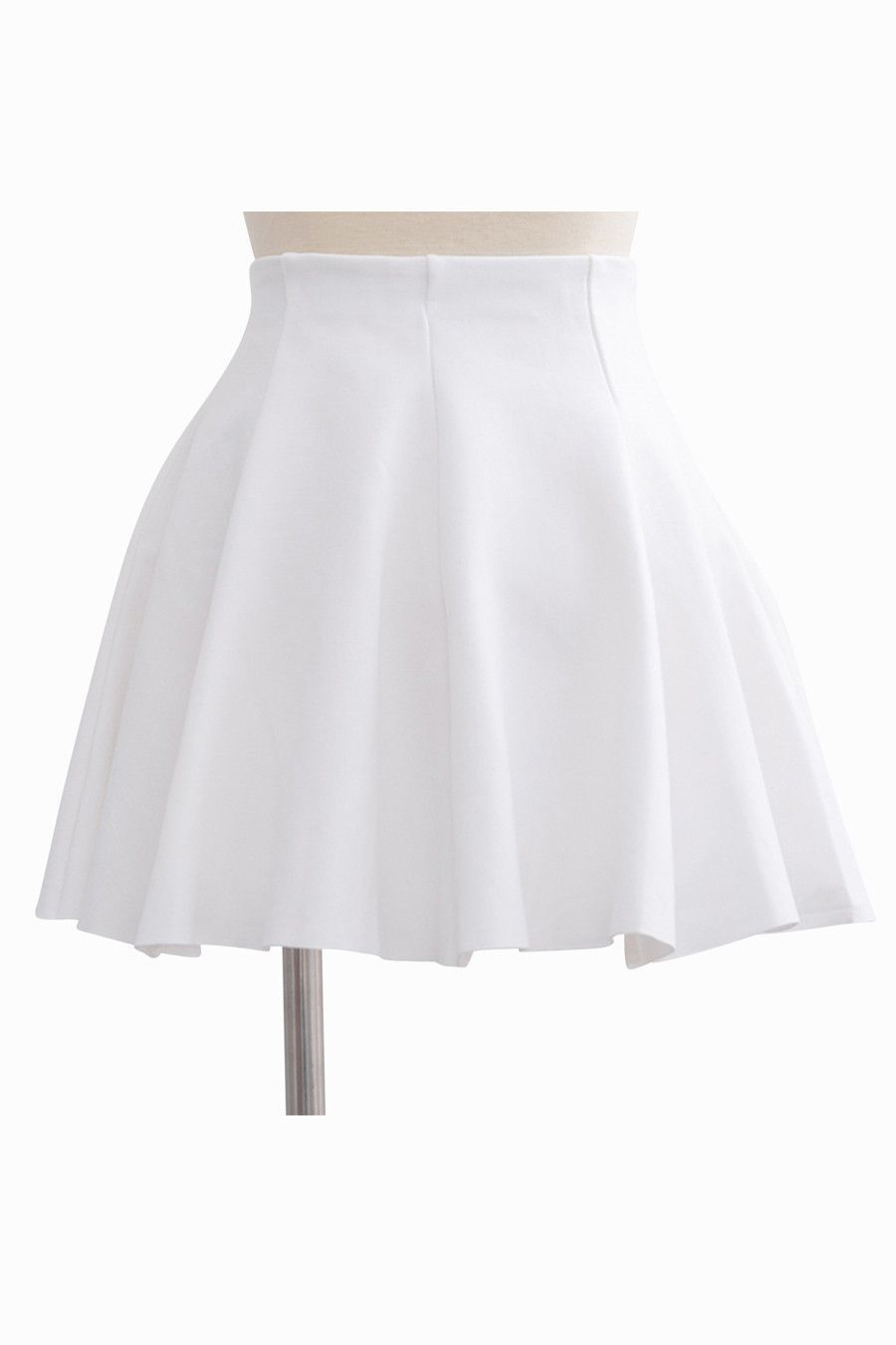 This item is shipped in 48 hours, included the weekends. This gorgeous short white skirt is the perfect fun and flirty accent for any outfit. The gentle folds give the skirt a sense of bounce and move